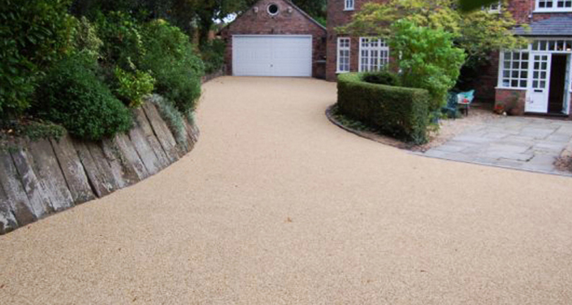 Image shows a large resin driveway in Bristol, installed by the team at JD Resin Driveways